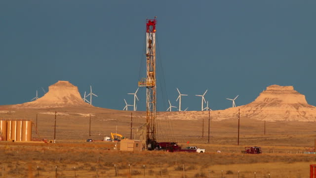 hd video drilling rig and pawnee buttes national grasslands colorado - drilling rig stock videos and b-roll footage