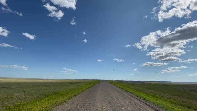 pov video driving in grassland national park, saskatchewan, canada - car point of view stock videos & royalty-free footage