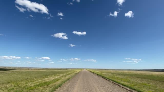 pov video driving in grassland national park, saskatchewan, canada - national grassland stock videos & royalty-free footage