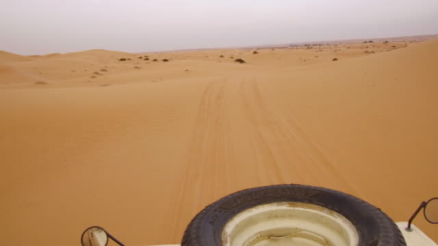 video driving through a desert in a tan jeep - point of view stock videos & royalty-free footage