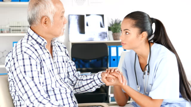 4K Video Female doctor encouraged senior patient