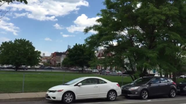 video footage captures the exterior of saint boniface church, wide/ close-up shots of the surrounding neighborhood, structures, eckhart park, the... - war stock-videos und b-roll-filmmaterial