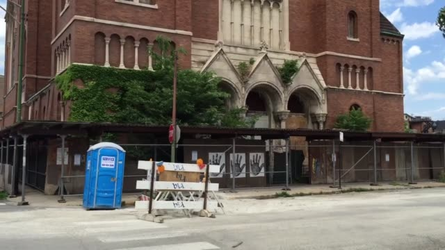 Video footage captures the exterior of Saint Boniface Church wide/ closeup shots of the surrounding neighborhood structures Eckhart Park the Chicago...
