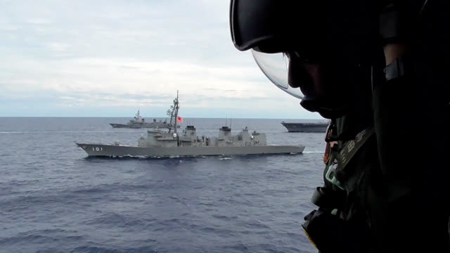 video footage from late june shows japanese vessels, among them the maritime self-defense force destroyer izumo, taking part in a joint training... - vessel part stock videos & royalty-free footage