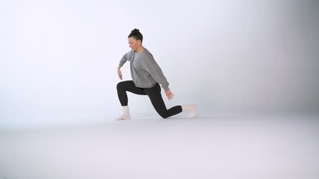 4k video footage of a ballet dancer modern dancing on white background - modern dancing stock videos & royalty-free footage