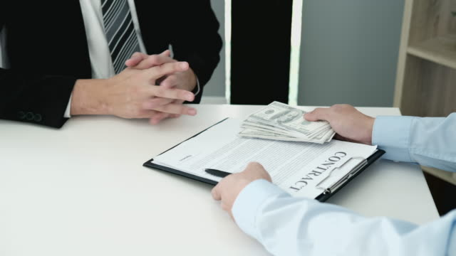 4k video footage of businessman refusing receive money offered by a man to making deal agreement a real estate contract and financial corporate - bribing stock videos & royalty-free footage