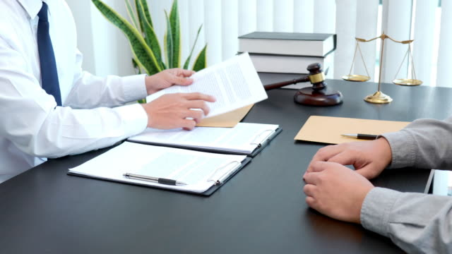 4k video footage of male lawyer consulting with client after agreement of contract in office - defendant stock videos & royalty-free footage