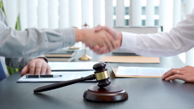 4k video footage of male lawyer shaking hands with client after contract agreement of discussing in office - defendant stock videos & royalty-free footage