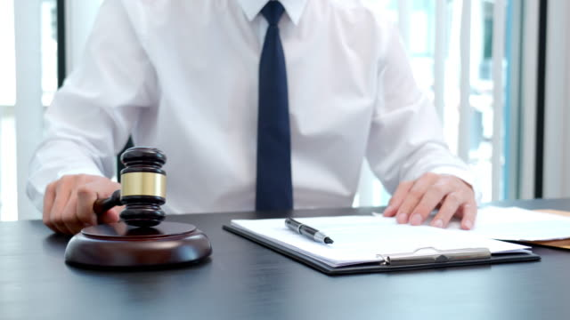 4k video footage of male lawyer working with paperwork and contract in office - defendant stock videos & royalty-free footage