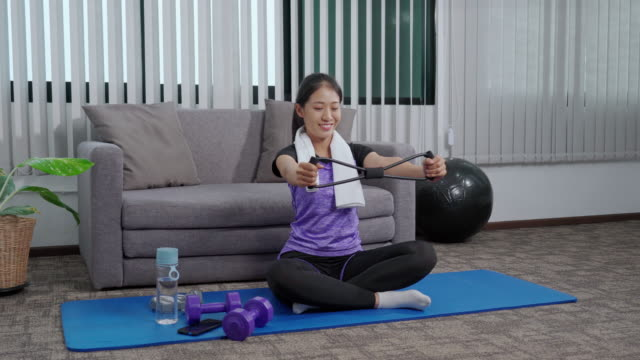 4k video footage of young asian woman doing yoga working out exercises at home - good posture stock videos & royalty-free footage