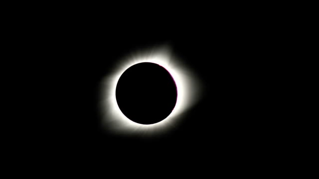 video footage partially recorded in timelapse mode from a position in madras oregon show the moment the moon passed in front of the sun in a total... - varo video stock e b–roll