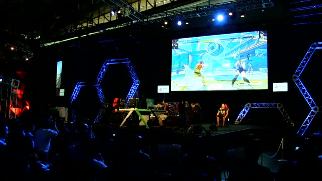 video footage shows digital gamers dueling in arena-like conditions complete with an emcee and commentators on the pa system during the japan game... - game show stock videos & royalty-free footage