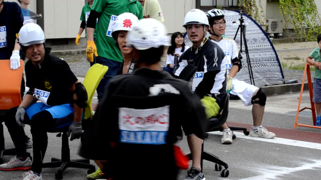 "video footage shows ""riders"" in action as they compete on caster-equipped office chairs during a two-hour endurance race in sakata, yamagata... - chair stock videos & royalty-free footage"
