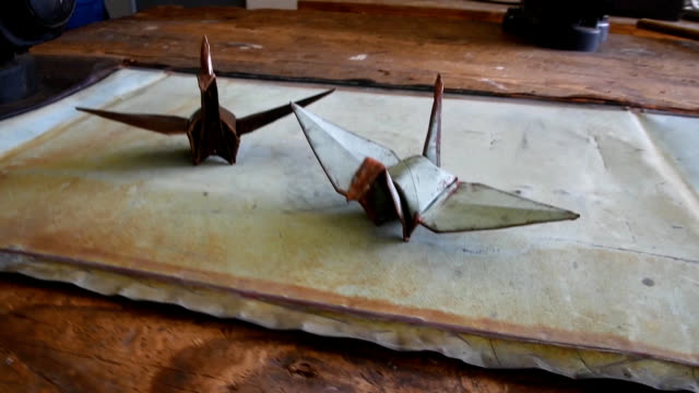 video footage shows students at the hiroshima municipal technical high school using vices and pliers to make origami folded cranes from sheets of... - folded stock videos & royalty-free footage
