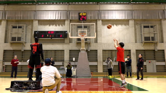 video footage taken at a basketball court in fuchu western tokyo shows cue an aiequipped robot besting two players belonging to professional... - コート点の映像素材/bロール