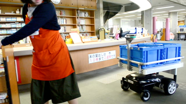 video footage taken at the tsukuba public library on april 11 shows thouzer an autonomous robotic cart developed for carrying heavy loads following a... - librarian stock videos & royalty-free footage