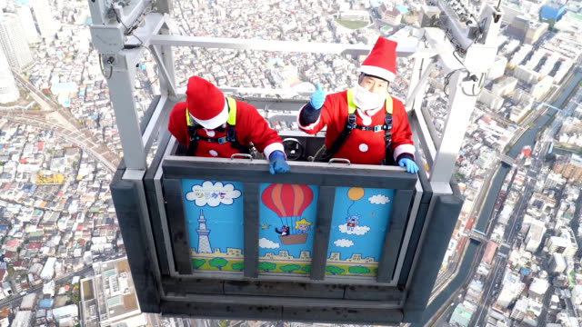 video footage taken both from a hovering helicopter and from inside the 450meterlevel observation deck of tokyo skytree located in sumida ward shows... - pair stock videos and b-roll footage
