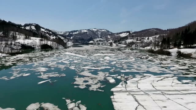 vídeos de stock, filmes e b-roll de video footage taken by drone on april 10 shows the surface of the lake formed by aburumagawa dam in uonuma niigata prefecture seemingly covered with... - water form
