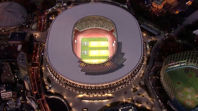 video footage taken during an evening flight over tokyo on nov. 29 shows the new national stadium that will serve as the main venue for the 2020... - オリンピック大会点の映像素材/bロール