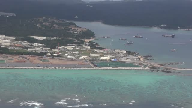 video footage taken from a helicopter on dec. 12 shows the landfill work under way off the henoko district of nago, okinawa prefecture, meant for a... - 埋め立てごみ処理地点の映像素材/bロール