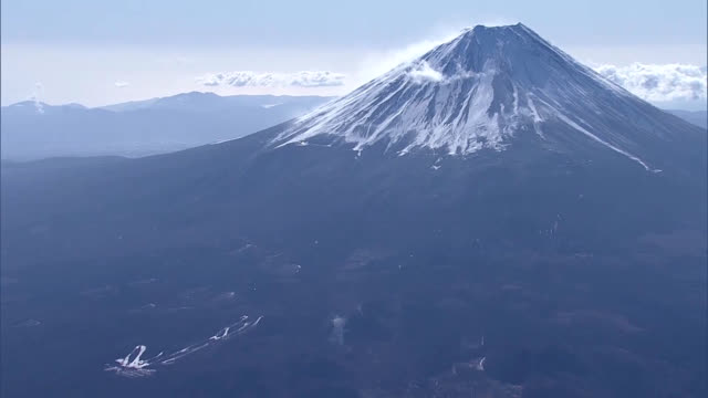 video footage taken from a helicopter on feb. 23 shows snow being blown off the prominent ridgeline of mount fuji by wind from the northwest. the day... - mt fuji stock videos & royalty-free footage