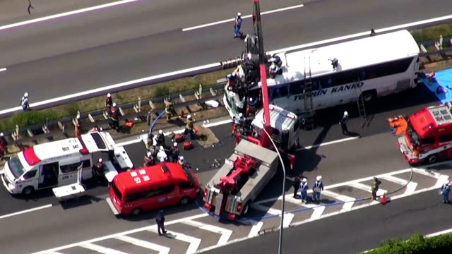 video footage taken from a helicopter on june 10japan shows a crane lifting a car off the top of a sightseeing bus shortly after a freak headon... - 交通事故点の映像素材/bロール
