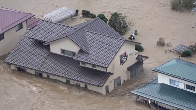 video footage taken from a helicopter on oct 13 shows areas flooded in nagano after the chikumagawa river broke through its barriers following... - 見せる点の映像素材/bロール