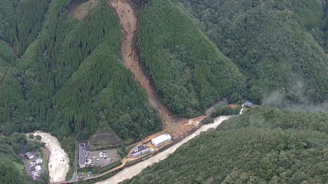 video footage taken from a helicopter on sept. 7 shows emergency workers and repair crews amid the damage brought to the village of shiiba, miyazaki... - missing people stock videos & royalty-free footage