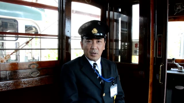 video footage taken from a spot overlooking the harimayamabashi intersection in the city of kochi shows the rare sight of three streetcars operated... - 路面電車点の映像素材/bロール
