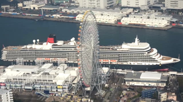 video footage taken from above osaka shows the luxury cruise liner queen elizabeth moored beside the tenpozan harbor village leisure facility on... - circumnavigation stock videos & royalty-free footage