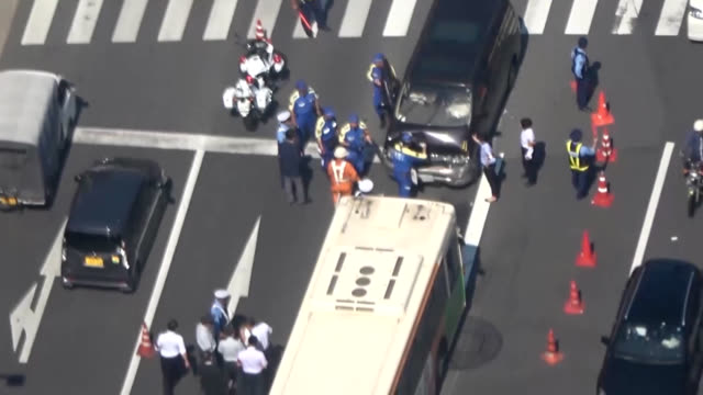 video footage taken from the air on june 25 shows the scene of a headon collision as a van plowed into a metropolitan bus in tokyo's koto ward the... - traffic accident stock videos & royalty-free footage