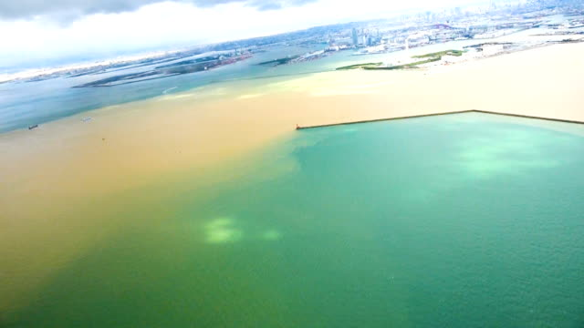 video footage taken from the air shows sediment flowing into osaka bay in the aftermath of powerful typhoon no. 21, which roared along western and... - bay of water stock videos & royalty-free footage
