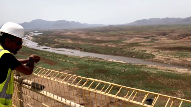 video footage taken in april shows work going in progress on the grand ethiopian renaissance dam a hydroelectric project being completed on a major... - possible stock videos & royalty-free footage