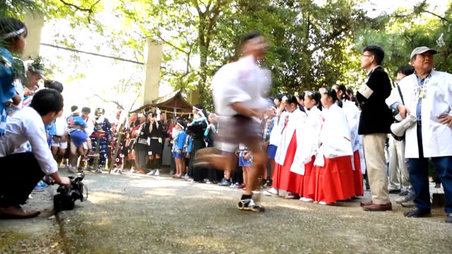 vídeos de stock, filmes e b-roll de video footage taken in asakura fukuoka prefecture shows pairs of men in costumes depicting mythical lions dancing and approaching little children... - prefeitura de fukuoka
