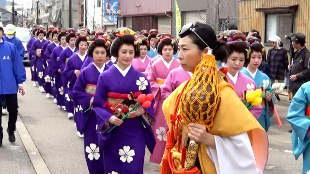 video footage taken in himi toyama prefecture shows a procession of unmarried women dressed in kimono and bearing ornate hairstyles parading through... - toyama prefecture stock videos and b-roll footage