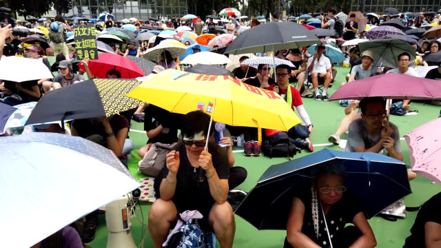 video footage taken in hong kong on aug 11 shows protesters against proposed extradition legislation during the 10th consecutive weekend of... - 日曜日点の映像素材/bロール