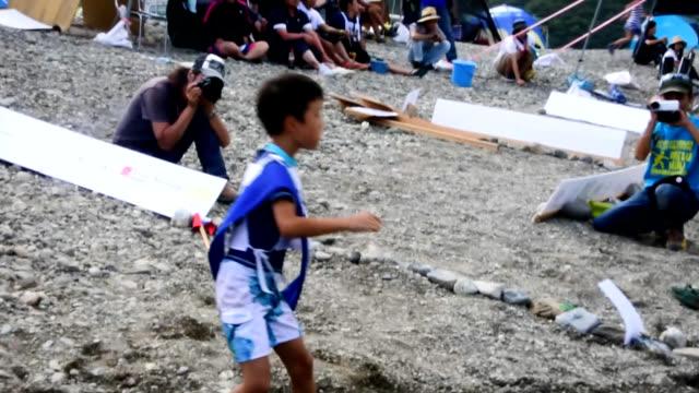 Video footage taken in Ino Kochi Prefecture shows participants skipping stones during the 15th annual Niyodogawa International Mizukiri Championship...