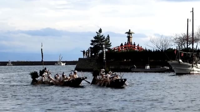 video footage taken in matsue, shimane prefecture, shows two teams of parishioners of mihojinja shrine seated in rowboats furiously splashing each... - shimane prefecture stock videos & royalty-free footage
