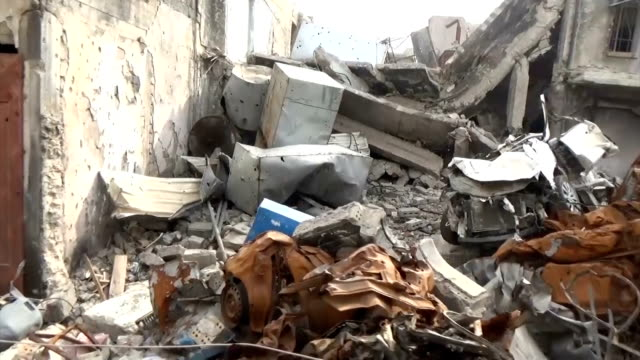 vídeos de stock, filmes e b-roll de video footage taken in mosul the secondlargest city in iraq shows wrecked vehicles and buildings in ruins as bulldozers attempt to clear rubble in... - iraque