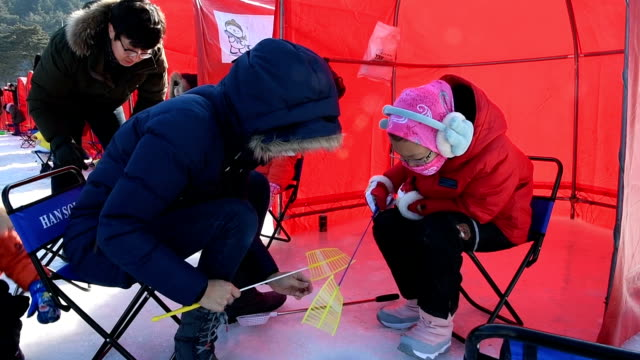 Video footage taken in Pyeongchang South Korea the venue for the 2018 Winter Olympics set to begin in February shows hundreds of colorful tents in...