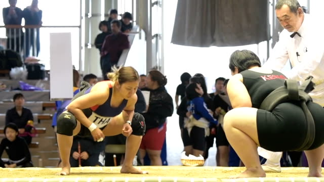 "Video footage taken in Sakai a satellite city to Osaka shows young women testing their wrestle mettle inside a sumo ""dohyo"" ring at an international..."