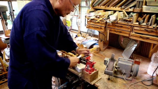 "stockvideo's en b-roll-footage met video footage taken in shunan yamaguchi prefecture shows 81yearold chikuyu okadera crafting ""shakuhachi"" bamboo flutes in his workshop from wellaged... - former"
