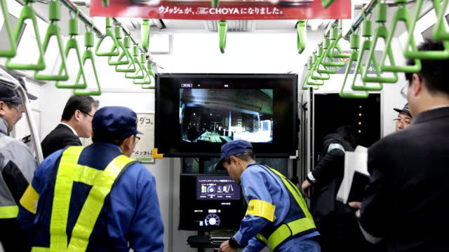 stockvideo's en b-roll-footage met video footage taken in the early hours of jan 7 shows east japan railway co employees testing out a driverless train on the yamanote line that loops... - videoato