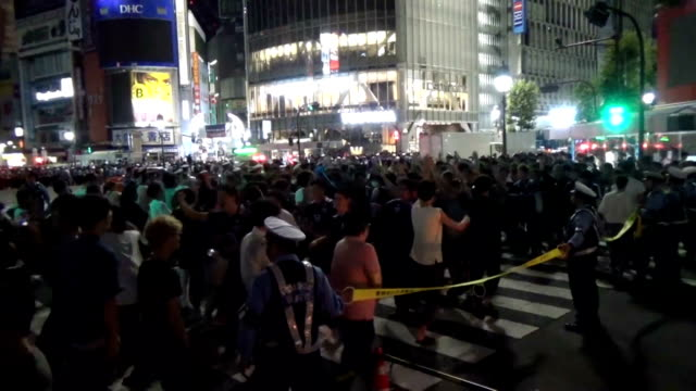video footage taken in the early hours of june 29 show jubilant japanese soccer fans rushing to celebrate in the streets of tokyo's shibuya district... - national team stock videos & royalty-free footage