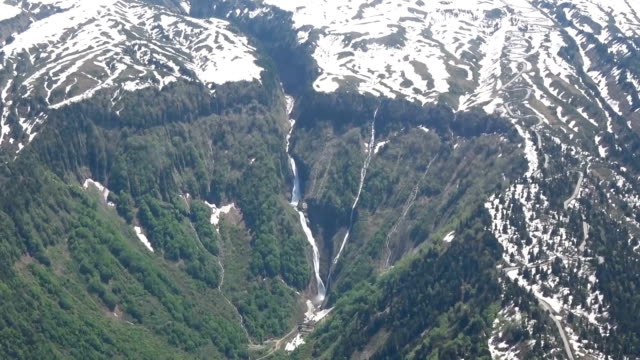 video footage taken in toyama prefecture on may 22 shows two waterfalls in the tateyama mountain range of the northern japan alps forming a v shape... - toyama prefecture stock videos and b-roll footage