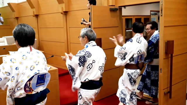 """video footage taken inside the municipal assembly hall of gujo, gifu prefecture, shows assembly members dressed in traditional """"yukata"""" summer... - yukata robe stock videos & royalty-free footage"""