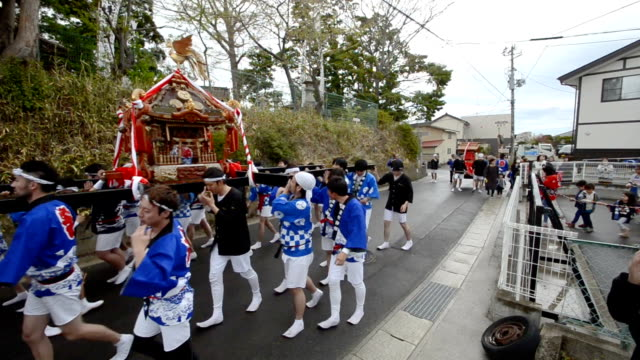 "video footage taken on april 15 at haragama in soma fukushima prefecture shows residents hoisting a ""mikoshi"" portable shrine and enjoying sword and... - hoisting stock videos & royalty-free footage"