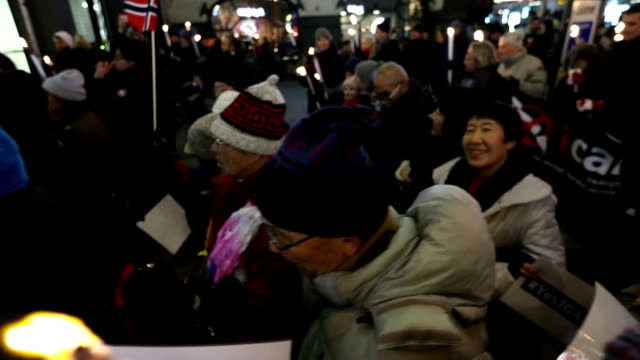 vidéos et rushes de video footage taken on dec 10 in oslo shows a torchlight parade through the city held to honor the international campaign to abolish nuclear weapons... - bombe atomique