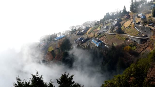 video footage taken on dec 5 shows the small village of shimoguri no sato part of iida nagano prefecture appearing out of the clouds obscuring the... - bedecken stock-videos und b-roll-filmmaterial