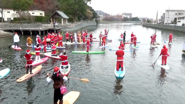 video footage taken on december 24in tokushimajapan shows a small flotilla of paddlers dressed in red santa claus suits and reindeer costumes making... - tokushima prefecture stock videos & royalty-free footage